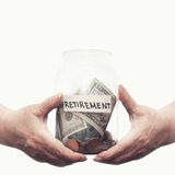 Elderly hands holding glass jar with money on a pension. Closeup royalty free stock photos