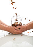 Elderly hands holding jar catching falling coins. Successful investment of the retirement fund concept stock image