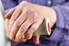 Elderly hands resting on stick Royalty Free Stock Photography