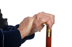 Elderly hands resting on stick Royalty Free Stock Photos