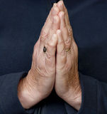 Elderly hands together in prayer Royalty Free Stock Image