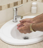 Elderly  Hands Washed in Bathroom Basin. Stock Photography