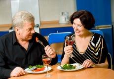 Elderly happy couple eating Royalty Free Stock Photos