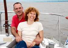 Elderly happy couple onboard the yacht Stock Photography