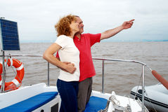 Elderly happy couple onboard the yacht Royalty Free Stock Images