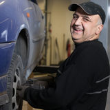 Elderly happy mechanic Stock Images