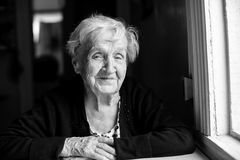 An elderly happy woman black and white portrait. Stock Photos