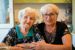 An elderly happy woman with her adult daughter. Stock Photo