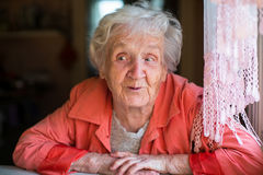 An elderly happy woman, ironic portrait. Royalty Free Stock Photography