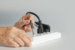Elderly have a problem mistake plugging socket Royalty Free Stock Photos