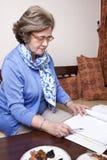 Senior Businesswoman about to Write Stock Photography