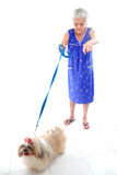 Elderly with her pet. On white floor royalty free stock image