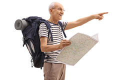 Elderly hiker holding a generic map and pointing Stock Image