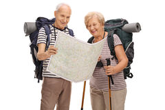 Elderly hikers looking at generic map Royalty Free Stock Image