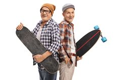 Elderly hipsters with a skateboard and a longboard. Looking at the camera and smiling isolated on white background Royalty Free Stock Photos