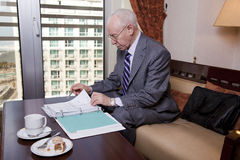 Senior Businessman Going Over Papers Royalty Free Stock Photos