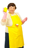 Elderly holding kitchen sponges Royalty Free Stock Photo