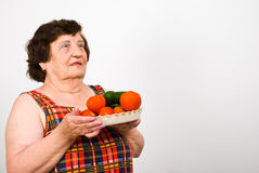 Elderly holding vegetable Royalty Free Stock Photos
