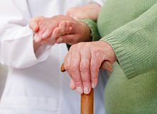 Elderly home care. Have cultural and geographic differences stock photo