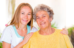 Elderly home care. Photo of happy elderly women with her daughter Royalty Free Stock Image