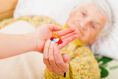 Elderly home care. Photo of elderly woman taking the medication stock photos