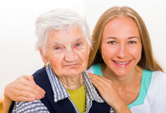 Elderly home care. Photo of elderly women with the caregiver stock photo