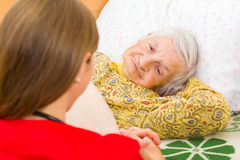 Elderly home care. Photo of elderly women with the caregiver stock photography