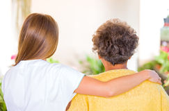 Elderly home care. Photo of elderly women with her caregiver royalty free stock images