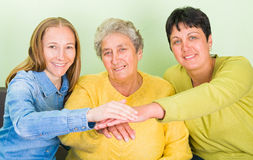 Elderly home care. Photo of elderly women with her daughters Stock Images