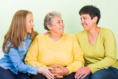 Elderly home care. Photo of elderly women with her daughters stock photo