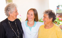 Elderly home care. Photo of elderly women and their carer stock photo