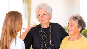 Elderly home care. Photo of elderly women and their carer Stock Image