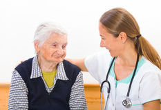 Elderly home care. Photo of elderly women with the young doctor Royalty Free Stock Image