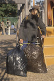 Elderly homeless woman Stock Photo