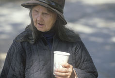 Elderly homeless woman drinking cup of coffee, Chicago, Illinois Stock Photo
