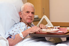 Elderly hospital patient ate dinner Royalty Free Stock Image