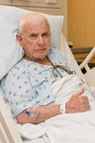 Elderly hospital patient in bed Stock Image