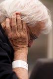 Elderly hospital patient wearing wristband stock image