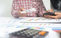 Elderly husband and wife are helping to calculate. Elderly husband and wife are helping to calculate the monthly miscellaneous expenses within the rental home royalty free stock image
