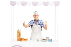 Elderly ice cream vendor giving thumb up Stock Photos