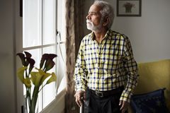 An elderly Indian man at the retirement house stock photography