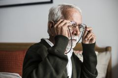 An elderly Indian man at the retirement house. Wearing an eyeglasses stock images