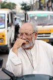 Elderly indian in traffic jam Stock Photo
