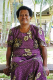 Elderly indigenous Fijian woman. In her 70`s sit outside her village home.  Real people copy space Royalty Free Stock Photography