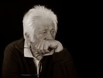 Elderly and intelligent man. Black and White Portrait of an elderly and intelligent man with a serious expression Royalty Free Stock Images