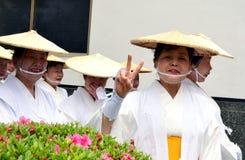 Elderly Japanese festival dancer showing V sign stock image