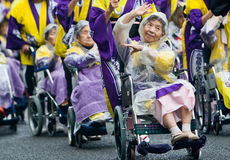 Elderly Japanese Festival Dancers in wheelchairs stock images