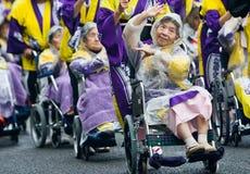 Elderly Japanese Festival Dancers in wheelchairs. Kagoshima City, Japan, November 3rd, 2008. Elderly Japanese Festival Dancers in wheelchairs brave the rain at stock images