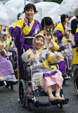 Elderly Japanese Festival Dancers in wheelchairs. Kagoshima City, Japan, November 3rd, 2008. Elderly Japanese Festival Dancers in wheelchairs brave the rain at royalty free stock photography