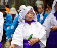 Elderly Japanese folk dancer. Koya, Japan - June 14, 2011: Elderly folk dancer in traditional clothes during Aoba festival, an annual event celebrating the stock photography